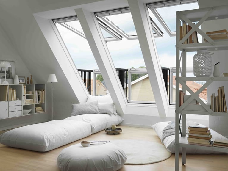 Railings fold out when this set of three large specialty roof windows opens, creating an exterior balcony.