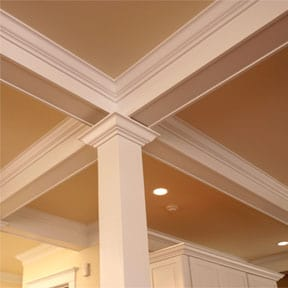 Square wooden column and distinctive moldings add style to this elegant room.