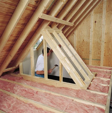 Framing for a light shaft that will funnel light from the roof to the room below is built in this attic. When the framing is finished, drywall will be added.