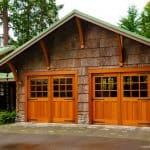 Craftsman bungalow-style garage with swing-out, real wood carriage, dual garage doors.