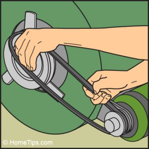Diagram of hands fitting a new motor pulley onto a furnace motor.