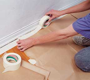 Tape protective drop cloths to the floor.