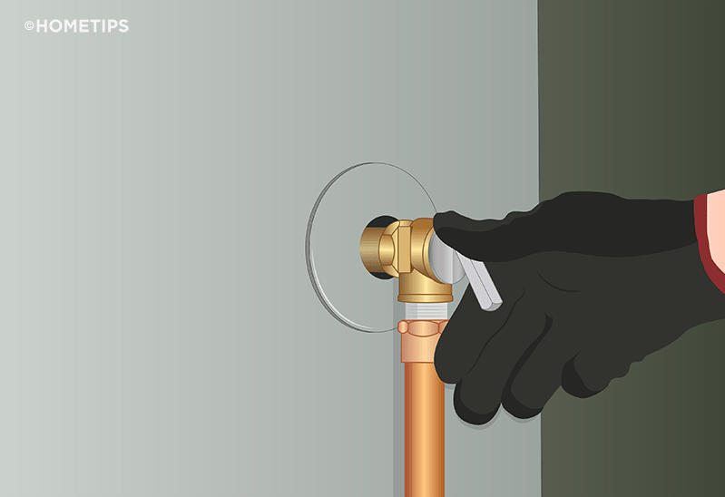 Gloved hand lifting the lever on a T&P valve on side of a water heater.