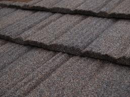 Brown stone-coated steel shingle roofing.
