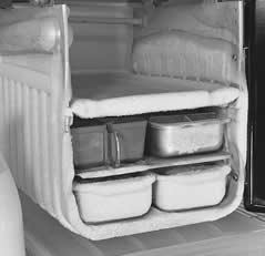 Freezer compartment of a refrigerator including frozen ice cube trays.