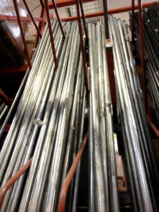 Galvanized steel pipes in varying sizes arranged vertically.