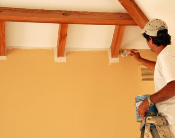 Establish a straight edge between colors and cut-in around trim using a brush.