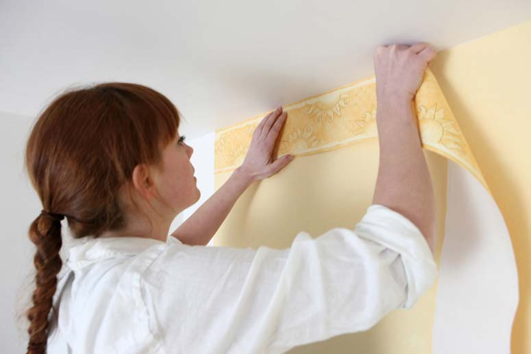 Top border adds a decorative element to wallpapered wall.