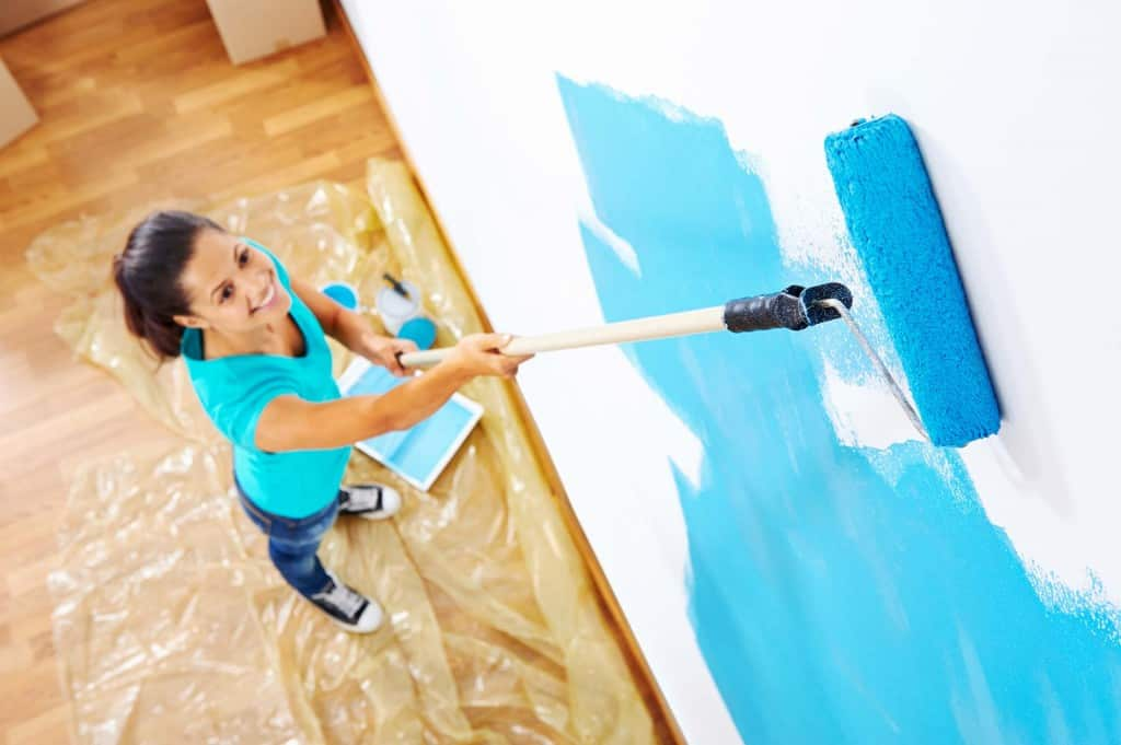 painting with a roller on extension pole