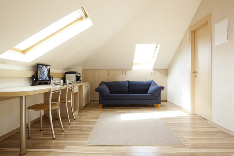 This attic office space is given natural light and a view through generous skylights.