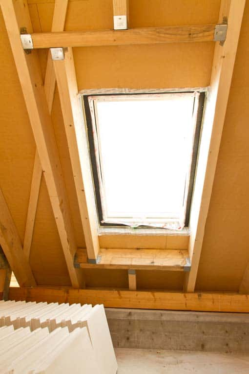 Interior framing shows how joists are constructed around the skylight opening in the roof.