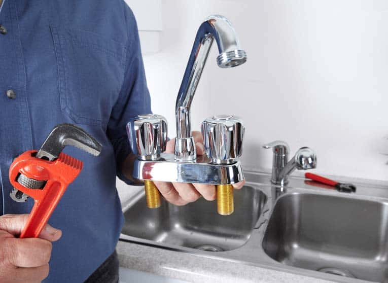 This faucet is not going to work on that sink! Make sure you buy a faucet that will fit the number of holes in your sink.