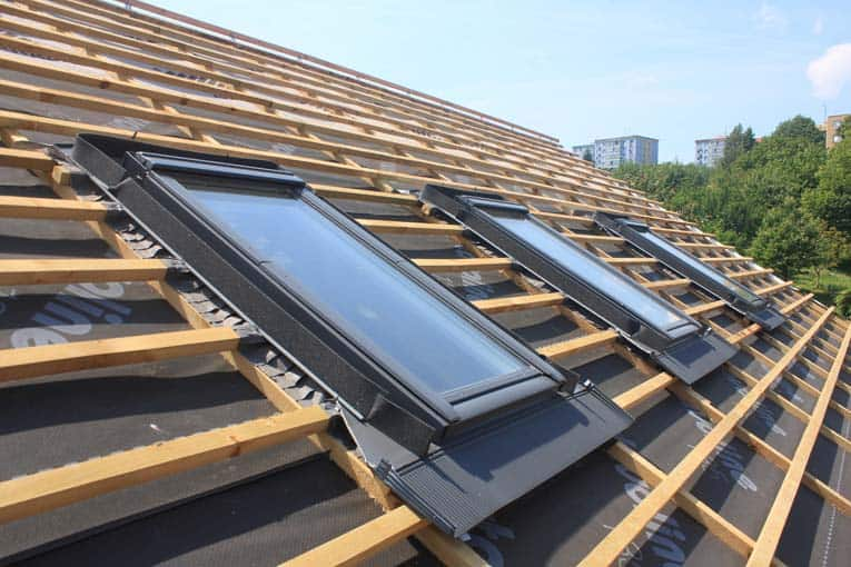 Skylights have integral metal flashing that seals them into the surrounding roofing.