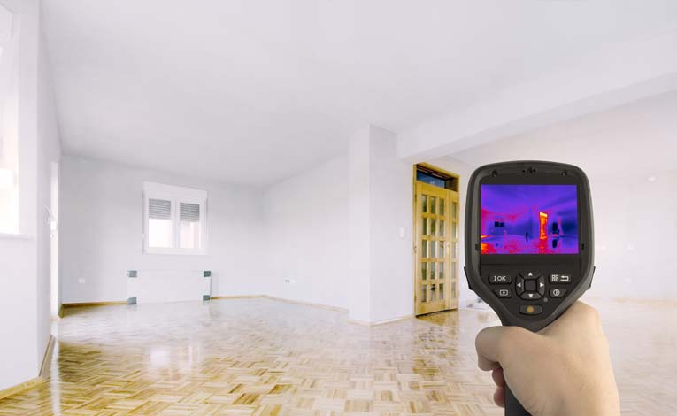 From inside a house, an infrared thermal detector can see energy leakage around doors and windows.