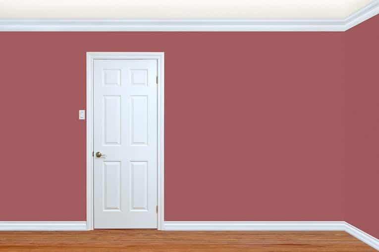 Painting interior trim a contrasting color (or white, in this case) turns woodwork into a stylish feature.