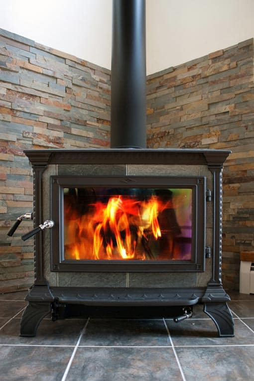 The basic elements of a wood stove installation are 1) the stove, 2) a flue, and 3) a non-combustible hearth and wall.