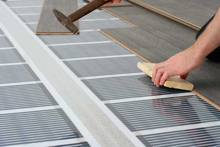 This infrared-carbon electric heating system is designed to go directly beneath surface flooring.