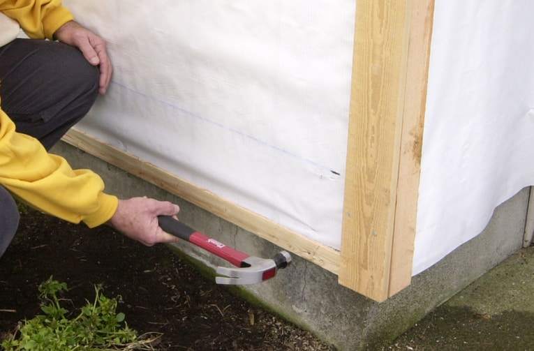 Install a starter strip along the bottom edge of the wall. Be sure it's level.