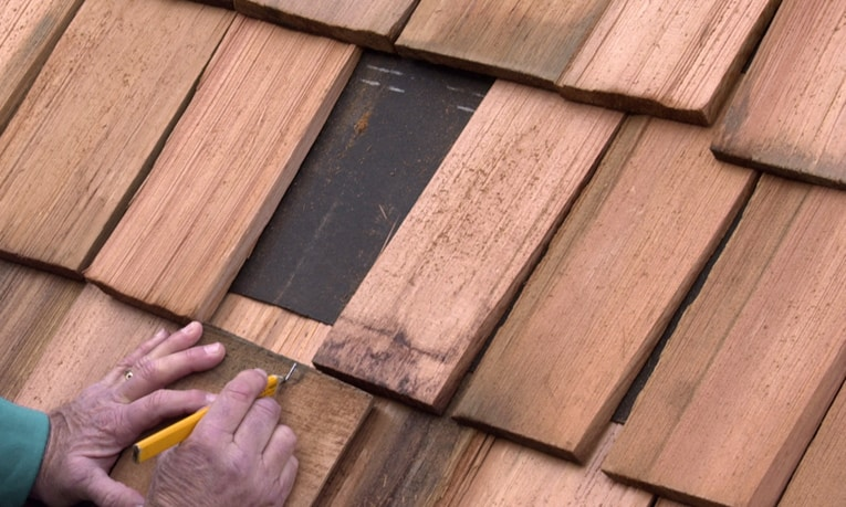 Measure for the width of the replacement shingle, allowing about 1/2 inch of spacing on both sides.