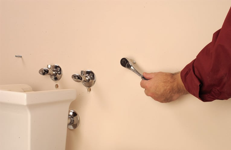 Attach wall and floor fasteners.