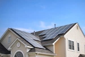Photovoltaic (PV) solar panels on house roof