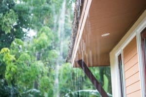 rain pouring down roof eaves